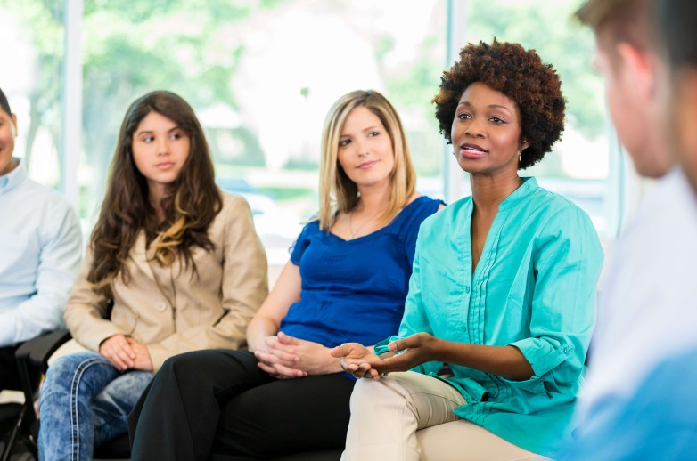 Image of people in a counseling session setting